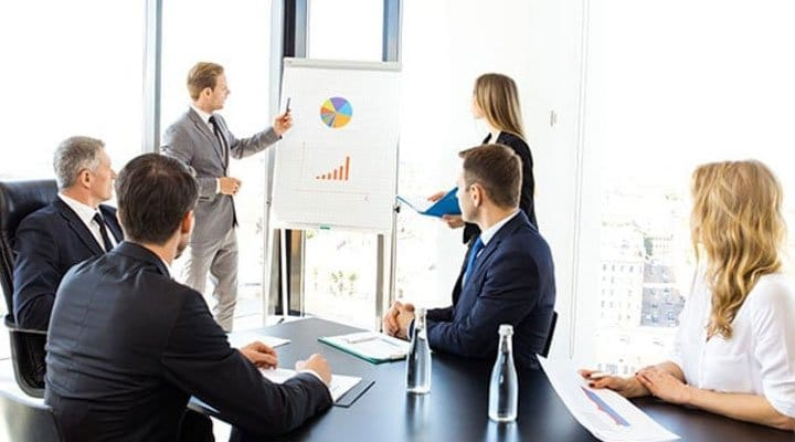 man-proposing-a-plan-to-his-team-members
